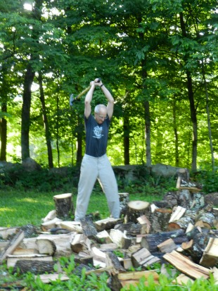 Tim splitting wood.