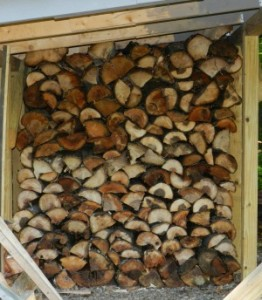 Filling the woodshed with next winter's firewood.